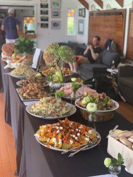 A buffet table laden with lunch for hungry tennis players