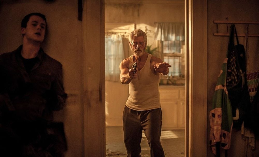 Stephen Lang and Dylan Minnette in Don't Breathe. Action thriller movies streaming now.
