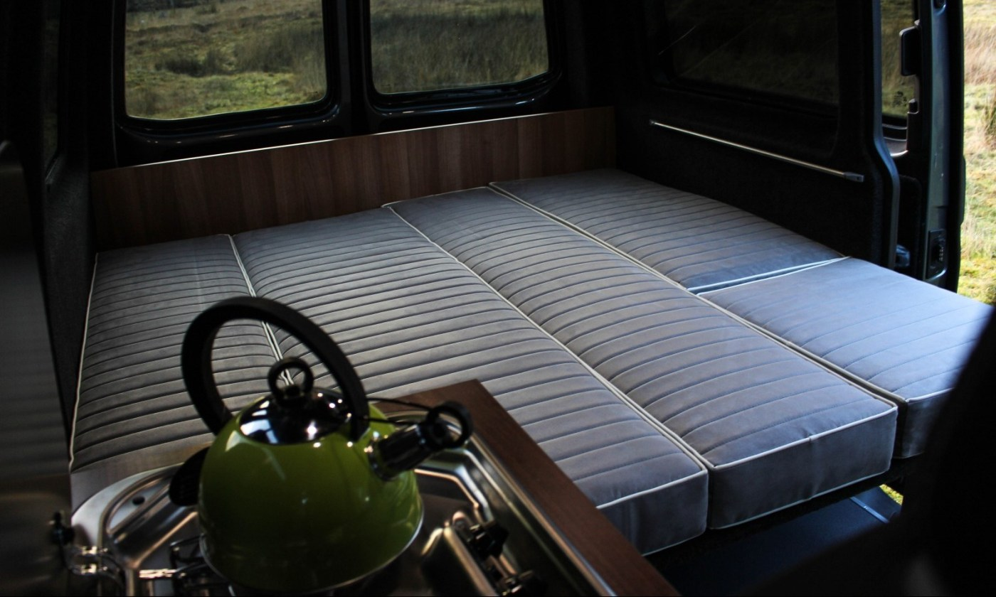 VW T5 Campervan Conversion Comfortline fitted with bespoke full width bed and gas 2 burner hob