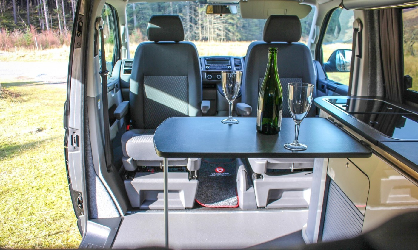 VW T5 Campervan Conversion fitted with swivel seats and sliding table
