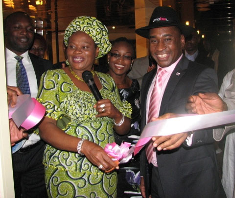 Hon Minster for information and Communications Prof Dora Akunyli cutting the ribbon for the Anabel ultra modern Experience center in Abuja, while the President, Anabel group, Nicholas Okoye holds the ribbon