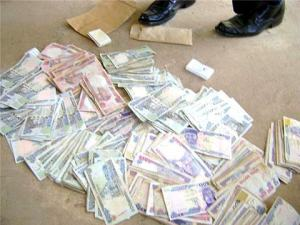 The recovered stolen money.