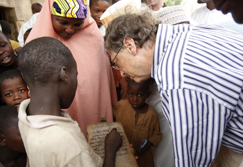 • Mr Bill Gates interacting with children in a Quranic School in Kano City, in Kano State during his visit to assess the on-going polio eradication programme in the country. Photo courtesy Bill & Melinda Gates Foundation.