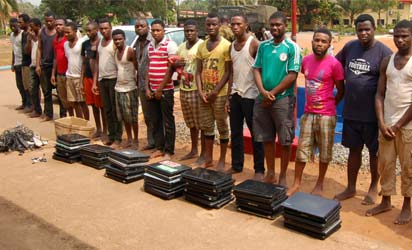 The arrested  suspected Yahoo-Yahoo Boys  with tools in Benin, yesterday.
