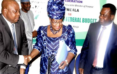 2013 Budget: From left, Accountant General of the Federation , Mr. Jonah Otunla, Minister of Finance, Dr. Ngozi Okonjo Iweala  and Director General , Budget Office of the Federation, Dr. Bright Okogu at a Press briefing on the 2013 Federal Budget in Abuja. Photo by Gbemiga Olamikan.
