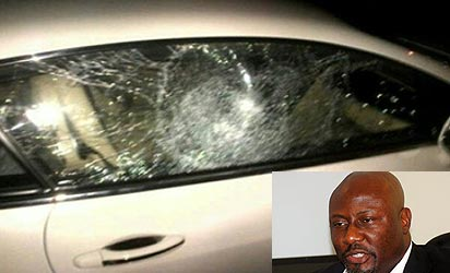 *Dino's car after the attack (Inset) Dino Melaye