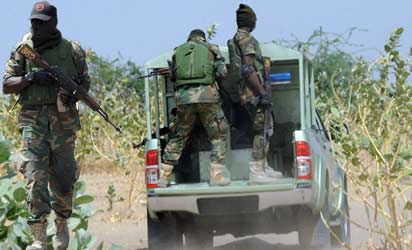 Officers of the Joint Military Task Force (JTF) patrolling  in Maiduguri in a sweeping offensive against Boko Haram militants.  AFP PHOTO/