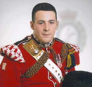 This handout image released by Britain's Ministry of Defence on May 23, 2012 shows Drummer Lee Rigby, who was killed in an attack on a London street on May 22, 2013, posing for a photograph. AFP