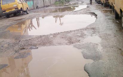 Ottor-Wharf/Awodi-Ora Road in Ajegunle...in a bad state