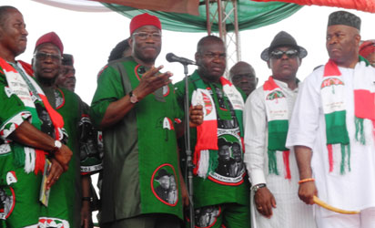 President Goodluck Jonathan speaking while been flanked by Alhaji Bamanga Turkur, PDP National Chairman (left) and Comrade Tony Nwoye, PDP Governorship Candidate in Anambra (right) with other PDP top stalwarts during the rally.