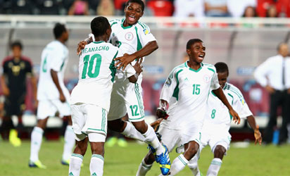Kelechi Iheanacho, Chigozi Obasi, Raymond Japhet and Abdullahi Alfa of Nigeria celebrate their victory after the FIFA World Cup UAE 2013 Final between Nigeria and Mexica at Mohamed Bin Zayed Stadium on November 8, 2013 in Abu Dhabi, United Arab Emirates. (Photo FIFA/FIFA)
