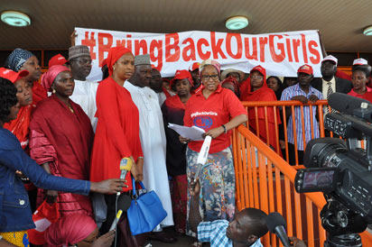 Chibiok Girls : Mrs. Maryam Uwais addressing newsmen and Abuja Family members of #Bringbackourgirls shortly after filing a suit against FCT Commissioner of Police who banned rallies in Abuja. Photo: Gbemiga Olamikan.