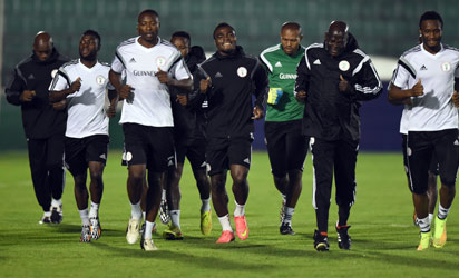 BRAZIL, Campinas : Nigeria's team members jog during a training session in Campinas, Sao Paulo, on June 18, 2014, during the 2014 FIFA World Cup. AFP PHOTO