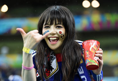 A Japanese supporter gestures as she waits for the start of the Group C football match between Ivory Coast and Japan at The Pernambuco Arena in Recife on June 14, 2014, during the 2014 FIFA World Cup.  AFP PHOTO / JAVIER SORIANO