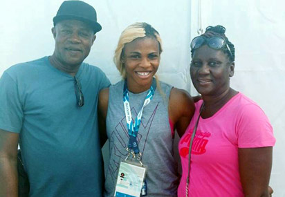Bolt Me Up... Mr and Mrs Bolt wishing Blessing Okagbare well in Glasgow 2014.
