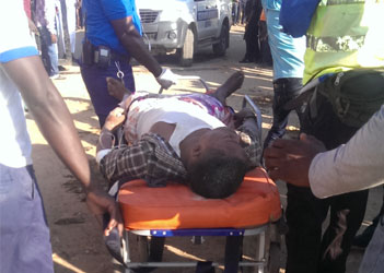 A survivor of the Synagogue Church Of All Nations building collapse being wheeled out