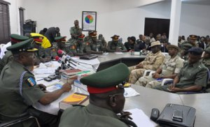 Members of the court martial sit during the inauguration to try soldiers accused of mutiny tasked with fighting Boko Haram militants in Abuja on October 2, 2014. Nearly 100 soldiers tasked with fighting Boko Haram militants in Nigeria's far northeast appeared at a military court martial on Thursday, facing a range of charges including mutiny. The hearing comes just weeks after a tribunal sentenced 12 soldiers to death following their conviction for shooting at their commanding officer in the Borno state capital, Maiduguri, in May. AFP PHOTO