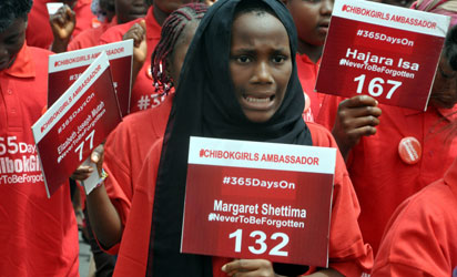Children under the auspices of  Chibok Girls Ambassadors march to press for the release of 219 schoolgirls abducted by Boko Haram Islamists during a demonstration at ministry of education in Abuja, on April 14, 2015.  Nigeria's president-lect Muhammadu Buhari cautioned he could not make promises on the return of 219 schoolgirls kidnapped by Boko Haram, as the country marked the first anniversary of their abduction. AFP PHOTO