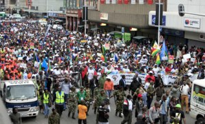"""Thousands of people take part in the """"peace march"""" against xenophobia in Durban, South Africa, on April 16, 2015. South African President Jacob Zuma on April 16 appealed for the end of attacks on immigrants as a wave of violence that has left at least six people dead threatened to spread across the country. In the past two weeks, shops and homes owned by Somalis, Ethiopians, Malawians and other immigrants in Durban and surrounding townships have been targeted, forcing families to flee to camps protected by armed guards.   AFP PHOTO"""