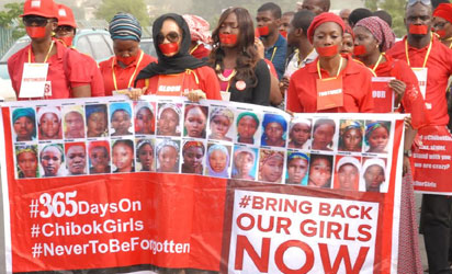 Members of #BringBackOurGirls (#BBOG) group on a silence protest match to show  the sorrowful state of the abducted Chibok school girls who have being in captivity a year ago in Abuja yesterday. Photo  by Gbemiga Olamikan