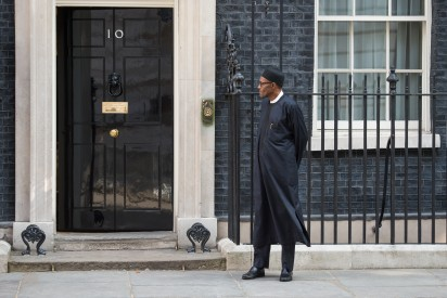 Nigeria's President-elect Muhammadu Buhari stands in Downing Street following a meeting with Britain's Prime Minister David Cameron in central London on May 23, 2015. AFP PHOTO / LEON NEAL