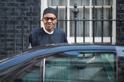 Nigeria's President-elect Muhammadu Buhari gets into his car in Downing Street, central London following a meeting with Britain's Prime Minister David Cameron (not pictured) in London on May 23, 2015. AFP PHOTO / LEON NEAL