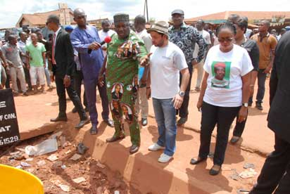 •Road inspection: L-R: Gov. Ifeanyi Ugwuanyi of Enugu State addressing the Site Engineer of the Greylines company, Engr.George skayrak and residents of Emene, as his Deputy, Hon. Mrs. Cecilia Ezeilo looks on, when he inspected the old Emene road..yesterday