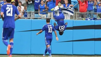 Moses celebrates his goal