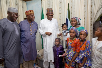 President Buhari introduces to ex-governor Amaechi and Fayemi his grandchildren in Daura during Sallah