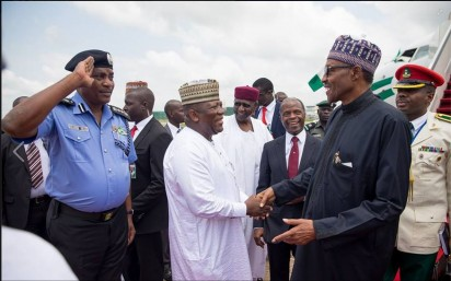Buhari exchanges pleasantries from government officials as he arrives Abuja from the 70th UN General Assembly in New York, USA, on Wednesday