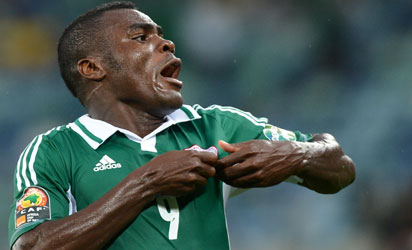 A file picture taken on February 6, 2013 shows Nigeria's forward Emmanuel Emenike celebrating after scoring a goal during the 2013 African Cup of Nations semi-final football match Mali vs Nigeria in Durban. Nigeria striker Emmanuel Emenike on October 20, 2015 announced his retirement from international football, after a barren spell in front of goal.    AFP PHOTO