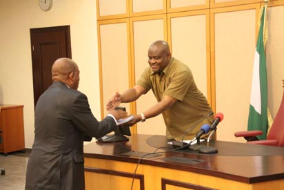 report: Governor Nyesom Wike of Rivers State (right), receiving the report of the Rivers State Commission of Inquiry on the Sale of Valued Assets from the Chairman,  Justice George Omereji, at Government House,  Port Harcourt, yesterday.