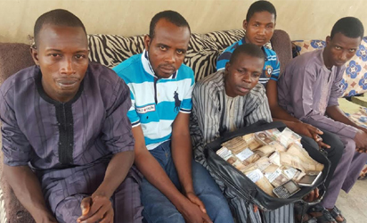 Suspected kidnappers of Chief Falae with their leader Abubakar Auta holding N823,900 of the ransom in Akure