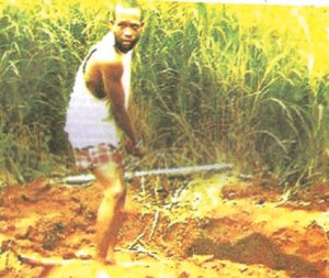 Ojoko, the suspect excavating the shallow grave