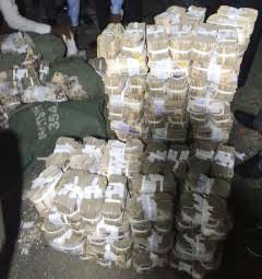 Part of the N137m recovered from fleeing robbers in Port Harcourt. Photos Jimitota Onoyume.