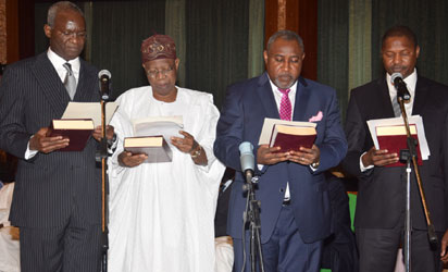 MINISTERS 6 L-R; New Ministers, Mr.  Babatunde Fashola (Power, Works and Housing); Lai Mohammed(Information); James Ocholi, (State, Labour and Employment); and Alh. Abubakar Malami (Justice) taking the oath of Office as Federal Ministers during their swear-in ceremony, held at the Presidential Villa Abuja. Photo by Abayomi Adeshida 11/11/2015