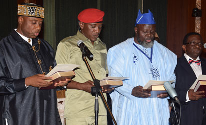 MINISTERS 8 L-R; New Ministers Rotimi Amaechi (Transportation); Solomon Dalong ( Youth & Sports); Barrister Adebayo Shittu (Communications); Prof. Isaac Folorunso Adewole (Health); taking the oath of Office as Federal Ministers during their swear-in ceremony, held at the Presidential Villa Abuja. Photo by Abayomi Adeshida 11/11/2015