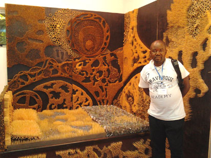 • Sebastine Ugwuoke infront of his winning work