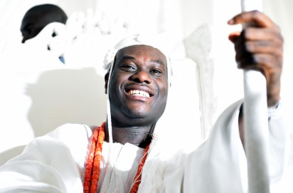 The new Ooni of Ife, Oba Adeyeye Enitan Ogunwusi sits for his coronation at Ile-Ife in southwest Nigeria, on December 7, 2015. 41-year-old multi-millionaire Adeyeye Enitan Ogunwusi, has been officially installed as the new Ooni of Ife. The monarch is the spiritual leader and the most influential traditional monarch among the Yoruba people of Nigeria's southwest .AFP