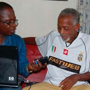 Late Sam Ibiam (right) being interviewed by a journalist