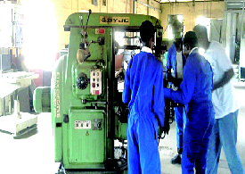 Students of Federal Science and Technical College, Yaba in one of their engineering workshops during a hands-on training