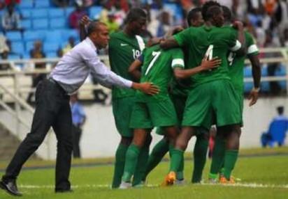 File: Super Eagles players celebrate with coach Sunday Oliseh