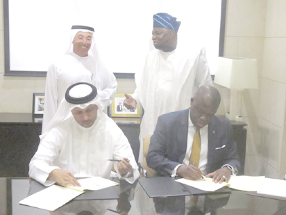 The Lagos State Attorney General and Commissioner of Justice, Mr. Adeniji Kazeem and the Chief Executive Officer of Smart City Dubai LLC, Mr. Jabber Bin Hafez,  signing the MoU for the Lagos Smart City, at the Emirate Towers, in the presence of the Chairman of Dubai Holdings and Deputy Prime Minister, His Excellency, Ahmad Bin Byat and Governor Akinwunmi Ambode of Lagos State.
