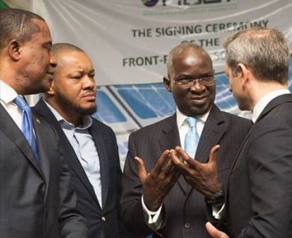 Hon. Minister of Power, Works & Housing, Mr Babatunde Fashola (2nd right), SAN shortly after the signing ceremony of Solar Power purchase agreement between National Bulk Electricity Trader(NBET) and Fourteen Solar Power Developer at the Transmission Company of Nigeria, (TCN), Maitama,FCT, Abuja on Thursday 21, July 2016.