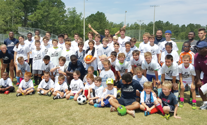 Kids that attended the summer soccer camp at USC with the coaches.