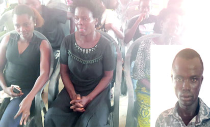 •From left, late Okorare's two wives in black and his daughter and son