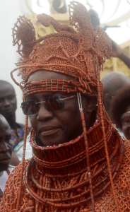 Newly crowned 40th Monarch of the Benin kingdom Oba Ewuare II walks to perform a rite during his coronation in Benin City, AFP PHOTO