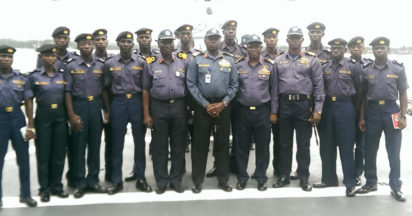 Rear Admiral James Oluwole (centre) with Officers of the Eastern Naval Command during the flag off  of Operation Sharkbite onboard NNS Okpabana at Onne seaport