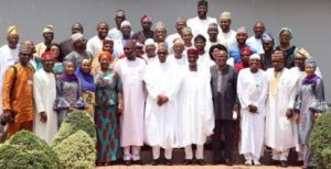 President Muhammadu Buhari flanked by the SGF, Mr. Boss Mustapher (6l) and the Chief of Staff to the President, Mallam Abba Kyari during the audience the President granted members of the Buhari Media Organisation led by Mr. Austin Buraimoh (5r) at the State House, Abuja.
