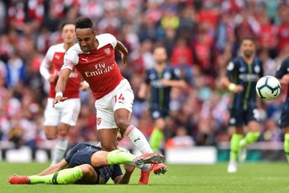 3cace8da3db Arsenal s Gabonese striker Pierre-Emerick Aubameyang is tackled by  Manchester City s English defender John Stones during the English Premier  League football ...